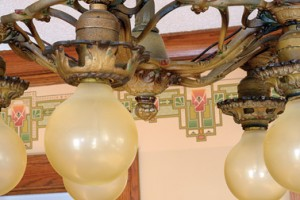 Colors of the bungalow's original polychromed light fixture blend well with Sonja Dahl's choice of wallpaper.