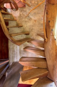 In one of the artist's most iconic early works, Spiral Stairs created from oak in 1930, form and function combine to give access to Esherick's upstairs bedroom.