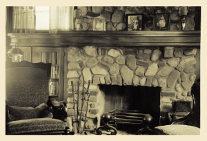 The original mantel and built-in bookshelves are still intact.